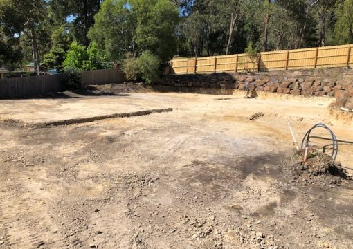 Site Cut incorporating existing rock wall