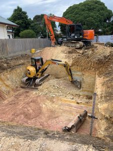 5 tonne excavator in a basement