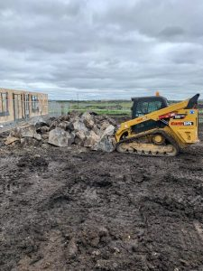 Track loader has removed a stockpile