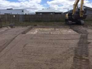 Rear of the site cut and a 10 tonne excavator onsite