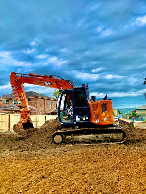 Hitachi excavator doing residential excavation