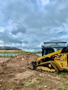 track loader removing soil