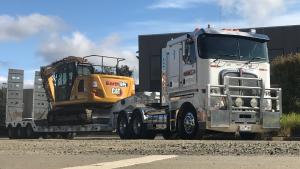 Kenworth truck and Caterpillar excavator